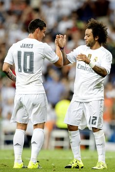 Marcelo celebrates a goal with teammate James Rodriguez during the Trofeo Santiago Bernabeu football match Real Madrid vs Galatasaray at the Santiago Bernabeu stadium in Madrid on August 18, 2015.