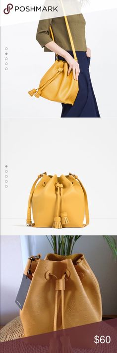 Zara yellow Bucket bag ZARA TASSEL SOFT BUCKET BAG, SOLD OUT EVERYWHERE!   STUNNING AND VERY CHIC MUSTARD YELLOW SOFT DRAWSTRING BUCKET BAG WITH BACK POCKET FROM ZARA,  AS SEEN ON MANY FASHION BLOGGERS!   BRAND NEW WITH TAG  AND ORIGINAL ZARA BOX. Zara Bags