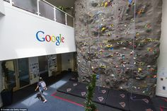 A view of office space with an indoor climbing wall at the Googleplex, the corporate headq...