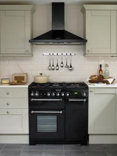 Propane Cooker Kitchen Victorian with Beige Tile Backsplash Beige Wall Black Range Black Range Hood Gray Cabinets