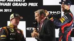 David Coulthard is drenched by Sebastian Vettel while interviewing Kimi Raikkonen (left).    Formula 1 drivers warned over using bad language in interviews >~:> http://awe.sm/m8pxV