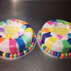 Round mud cakes rainbow coloured icing stripes