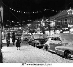 Christmas in the 1950s - City scene with snow, shopping, vintage downtown