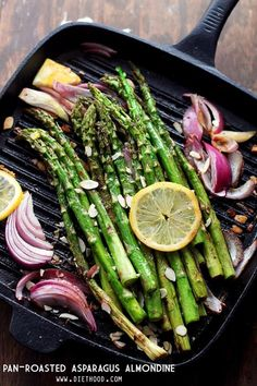Pan Roasted Asparagus Almondine: Asparagus spears sauteed with almonds, red onions and lemon slices.