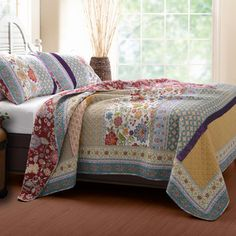 Outfit your master suite or guest room in timeless style with this inviting cotton quilt set, showcasing a patchwork motif.  Product...