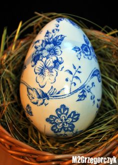 Blue and white decoupaged egg