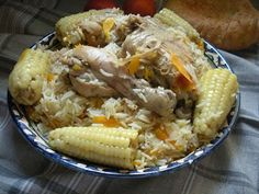 Uzbek Cuisine: Ju'hori palov (Pilaf with corn) 150 grams of vegetable oil  400 grams of meat (lamb, beef or chicken)cut in big chunks  2 big onions, peeled  3-4 medium sized carrots (300 grams of peeled and striped carrot)  1 big capsicum or 2 small  4-5 soft corns  Salt to taste  1 tbsp of crushed coriander seeds  1 tsp of cumin seeds  350 grams of rice