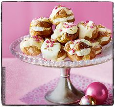 White Chocolate and Vanilla Profiteroles ~ choux pastries filled with vanilla crème fraîche, topped with crushed crystallised rose petals and pieces of gold leaf | from Sainsbury's Magazine