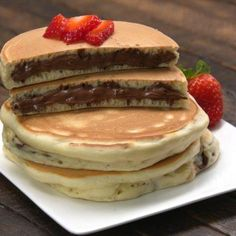 We bet nothing can beat your blues as well as these Nutella Stuffed Pancakes! 😍 TAG a Nutella lover to share this with! Pancakes Nutella, Fluffy Pancakes, Chocolate Pancakes, Think Food, Cafe Food, Diner Food, Aesthetic Food, Food Cravings, Food Videos
