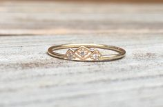 This could make a sweet promise ring <3 14k Diamond Mountain Ring, Mountain Stacking Ring, Triangle Ring, Diamond Stacking Ring, Midi Ring, Black Diamond, Blue Diamond, Outdoors by LieselLove on Etsy https://www.etsy.com/listing/293164271/14k-diamond-mountain-ring-mountain