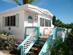 Gulf Breeze Cottage, Sanibel Island, FL with Turquoise Shutters and Porch Railing.