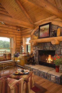 Log home, stone fireplace.