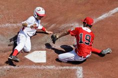 Tokyo, Japan's Shou Miyao, left, scores on a wild pitch by Tijuana, Mexico, pitcher Luis Manzo (19) in the third inning of the International Championship baseball game at the Little League World Series tournament, Saturday, Aug. 24, 2013, in South Williamsport, Pa. Tokyo, Japan won 3-2. (Matt Slocum/AP)