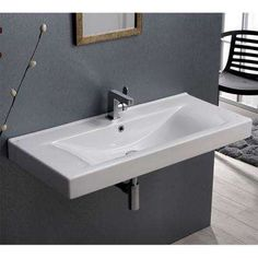 Nameeks Mona White Ceramic Wall-mount Rectangular Bathroom Sink with Overflow Drain at Lowe's. Modern 40 inch wall mounted bathroom sink with one pre-drilled faucet hole and an overflow. Sink is made out of high-quality ceramic. Sink is designed by Drop In Bathroom Sinks, Wall Mounted Bathroom Sinks, Drop In Sink, Bathroom Ideas, Bathroom Interior, Small Bathroom, Master Bathroom, Bathroom Renovation Cost, Contemporary Bathroom Designs