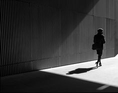 """OLYMPUS DIGITAL CAMERA - Want to see some beautiful street photographs that make use of light and shadows? Look no further than the project """"Man on Earth"""" by London-based photographer Rupert Vandervell."""