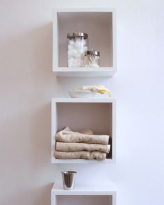 Bathroom Cubbyholes - Keep bathroom items neat and accessible with cubbyhole shelves for large items and surgical jars for small toiletries and accessories.