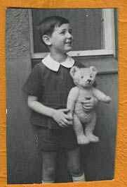 Vintage photo of a boy with his teddy bear.