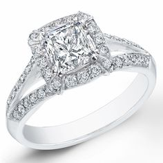 This beautiful engagement ring has a total weight of 1.31 Ct. It features a 0.71 Ct. Princess cut on the center with a color of D and clarity of SI1.