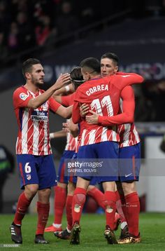 Atletico Madrid's Spanish forward Fernando Torres (R) celebrates a goal with teammates during the Spanish league football match Club Atletico de Madrid against Alaves at the Wanda Metropolitano stadium in Madrid on December 16, 2017. /