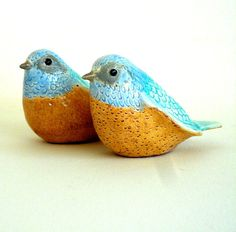 Translucent glazes in warm sand, sky blue and aqua mark this pair of lovebirds as truly unique. Perched on a window sill or in a bookcase, the pair will