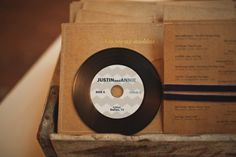 a playlist of the couple's favorite songs gifted on a cd made to look like an old record. too cute  Photography by taylorlordphotography.com