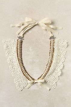 """Sparkling stones add a bit of tough glitz to crochet lace. By Akong London, an haute couture jewelry house that constructs each piece by hand using the highest quality materials..."" (Anthropologie, pretty bits 'n bobs) http://www.stylehive.com/browse/anthropologie.com/necklace"