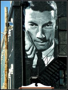 Richmond, Wayne County, Indiana. Pictures of blues and jazz artists dot the town. This portrait of Hoagy Carmichael is huge, over two stories from top to bottom. It is the largest mural I have come across done in black and white