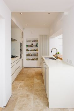 Having been asked to extend this existing semi-detached family home at Whitebeam Road, we decided new build was unnecessary. By reconfiguring internal partitions we provided a light filled and spacious kitchen/dining space which opens onto the mature garden.