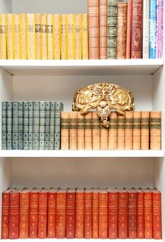 DIY::Organize Books by Color-This is one of the oldest tricks in the history of decorating, but few use And  it makes a HUGE difference in creating a pulled together look!