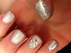 Gel nails, Vegas nails. White base, silver glitter, accent jewels