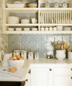 White kitchen with blue tile and accents