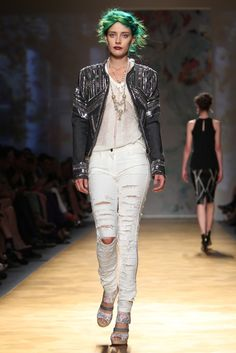 Nicole Miller RTW Spring 2014 - Want to dress up ripped jeans without sacrificing their toughness? Opt for an embellished leather jacket
