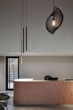 Elegant, harmonious and playful, the dental practice of Tandarts Verstraete offers a welcoming setting. Standout features of the interior, designed by Neels Architecten, include a textured reception desk in gum pink tiles and atmospheric pendant lighting. Soiree pendants lamps and Hedra lighting fixtures were selected, to create a contrast of rounded shapes and straight lines. Corridor Lighting, Office Lighting, Reception Desk Design, Corridor Design, Delta Light, Pink Tiles, Light Project, Commercial Design, Corporate Design