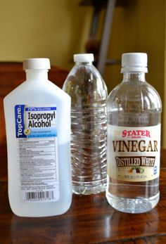 Clean your tub with a 1/2 cup of white vinegar and 1 cup of rubbing alcohol mixed in 4 quarts of warm water.  Spray tub, wait 15 minutes and rinse.