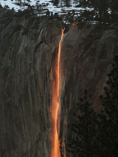 This is the Horse tail waterfall in the Yosemite National Park. Every year for a few days in February, the sun sets at a certain angle and illuminates the waterfall in luminescent orange and red, making it look like a molten lava.
