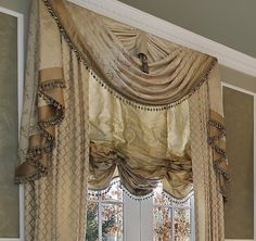 Last Updated on June 2018 Gold valances and swags are typically chosen for traditional rooms. It's common to see them in staple areas of the home like the living room, den, formal dining,… Traditional Window Treatments, Traditional Windows, Custom Window Treatments, Traditional Ideas, Custom Valances, Custom Curtains, Diy Curtains, Dining Room Windows, Dining Rooms