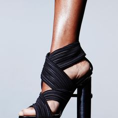Pleated Wrap Sandal featuring a bold tubular heel and gold plated hardware…