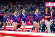 The U.S. women's Olympic gymnastics team marches onto the podium to begin qualifying in London.  Team USA led the team qualifications following the end of competition.  From L to R: Gabby Douglas, Aly Raisman, McKayla Maroney, Jordyn Wieber.  Kyla Ross was also a member of the team.