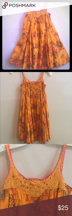 Catimini girls floral sundress Seriously adorable Catimini girls sundress with crochet and pleated bodice ( see photo). Elastic back and served hem. 100% lightweight cotton. Gorgeous tangerine orange with floral design. Summer must have. Catimini Dresses Casual