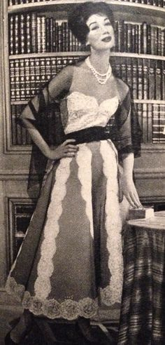 Coco Chanel- 1957 White lace strapless dress with black silk belt.  Elle Collections Printemps  March 4, 1957