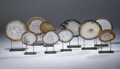 agate slices on distressed bronze stands