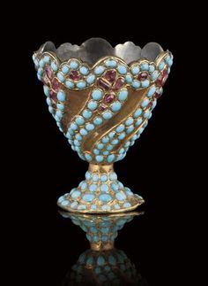 A QAJAR GOLD PLATED SILVER ZARF WITH RUBY AND TURQUOISE INLAY, IRAN, 19TH CENTURY