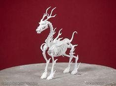 This is a digitally sculpted, 3D printed replica of a Qilin, or Kirin Skeleton. This is the beast often referred to as the Chinese Unicorn. It measures 4.8 inches long by 1.6 inches wide by 6 inches high. This piece is printed in a durable Nylon material.  The skeleton comes with a 2 page informational pamphlet about the Qilin, and a Certificate of authenticity, detailing the print number and the artists signature.  This model is made to order and may take up to 4 weeks to ship, although we…