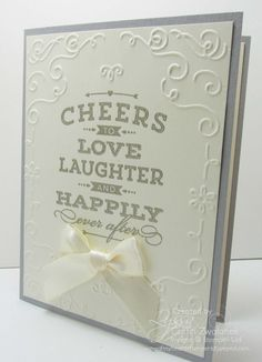 Posted 9-12-14 Cheers To Love stamp set Filligree Frame embossing folder Very Vanilla & Smoky Slate cardstock, 2014-16 In color DSP Stack Versamark & Pewter or Silver embossing powder Vanilla Satin Ribbon