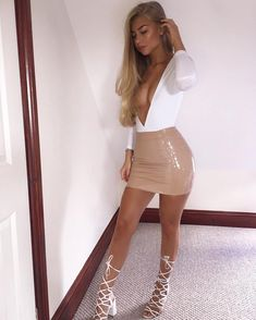"16e7ef49997 Jess Hunt on Instagram  "" ohpolly never lets me down 😍 Both the bodysuit  and skirt are from Oh Polly. This nude PVC skirt is giving me life 🙌🏽🙌🏽"""