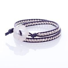 Wrap Bracelet: Sterling Silver Beads on Purple Leather Cord by Jonti Cameron. A great gift for that special lady in your life!