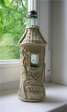 DIY Fairy Wine Bottle House idea - wrap an upcycled wine bottle with salt dough or polymer clay - could make this as a two separate bits the bottom and the roof separate as a base and lid then paint with acrylic paint and give it a clear varnish coat you could also use stones, sea shells, crystals and nature elements like bark, twigs, pebbles, in your design let your imagination run wild!!!!