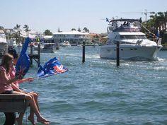 Flotilla of boats parade past our Mandurah jetty for Australia Day at Port Sails Canal Villa