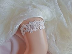 A personal favorite from my Etsy shop https://www.etsy.com/listing/255123124/wedding-garter-ivory-venice-lace-ivory