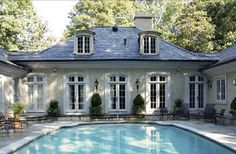I want a U shapped house that wraps around either a beautiful courtyard or a pool with french doors on all 3 sides of the house... <3